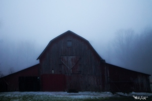 The fog makes the old barn look almost spooky.